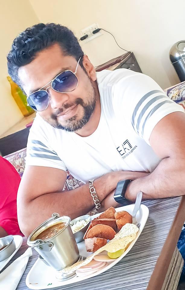 Image may contain: Sharanam Shah, smiling, sitting and sunglasses